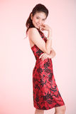 Red dress smile. Young Adult female in a red batik dress smile Royalty Free Stock Images