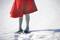 Red dress in the snow Stock Photo