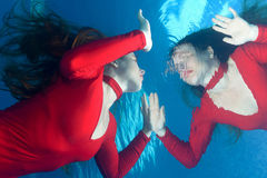 Red dress underwater Stock Photography