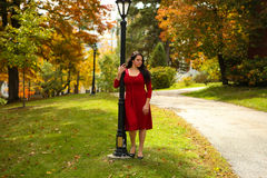 Red dress woman in foliage, path and light Stock Photo