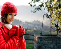Red dressed girl against Tuscany landscape Royalty Free Stock Photography