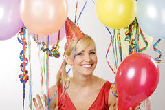 Red dressed girl in party with balloons Stock Image