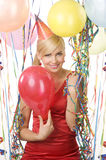 Red dressed girl in party with balloons Royalty Free Stock Photography