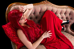 Red dressed lady in though Royalty Free Stock Image