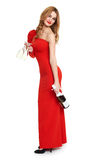 Red dressed woman with champagne and wineglass on white Royalty Free Stock Photography