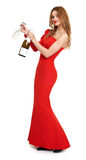 Red dressed woman with champagne and wineglass on white Stock Photo