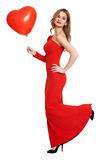 Red dressed woman with heart shape balloon - valentine holiday concept Royalty Free Stock Image