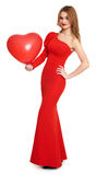 Red dressed woman with heart shape balloon - valentine holiday concept Stock Photo