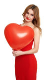 Red dressed woman with heart shape balloon - valentine holiday concept Stock Image