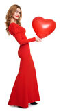 Red dressed woman with heart shape balloon - valentine holiday concept. Red dressed woman with heart shape balloon on white Royalty Free Stock Photos