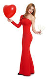 Red dressed woman with heart shape balloon and wineglass - valentine holiday concept Stock Images
