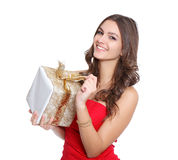 Red dressed women with a gift Stock Photography