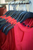 Red dresses in the store. Red dresses in the retail store on the hangers stock photo
