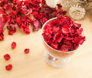 Red Dried flowers in glass on a wooden background Stock Images