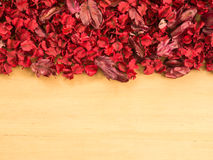 Red Dried flowers and leaf on a wooden plates background Royalty Free Stock Photos