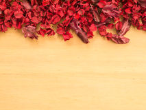 Red Dried flowers and leaf on a wooden plates background Stock Photos