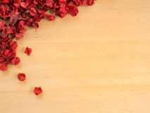 Red Dried flowers and leaf on a wooden plates background Royalty Free Stock Photography
