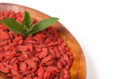 Red dried goji berries in a plat Stock Photo