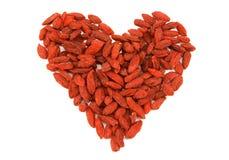 Red dried tibetan goji berries heart Royalty Free Stock Image