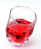 Red drink. In faceted glass Stock Photography