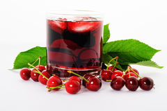 Red drink ank cherry. Red drink and ripe cherry berries Royalty Free Stock Photo