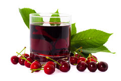 Red drink ank cherry. Red drink and ripe cherry berries isolated over white background Royalty Free Stock Photos