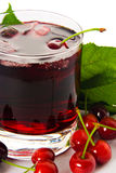 Red drink ank cherry. Red drink and ripe cherry berries Royalty Free Stock Images