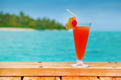 Red drink at a beach Stock Photo