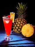 Red  drink  with cherry  and whole pineapple 24 Stock Photos