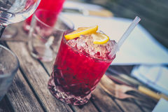Red Drink on Clear Glass With Lemon on Top Royalty Free Stock Photo