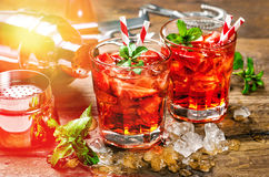 Red drink. Cocktail bar with party lights Royalty Free Stock Images