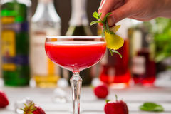 Red drink in coupe glass. Royalty Free Stock Photos