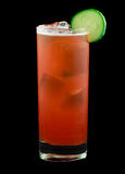 Red drink with a cucumber slice isolated on black. Drink called Ambrosia Swizzle that contains rum, vanilla liqueur, strawberries, cucumber, pineapple juice Royalty Free Stock Photography