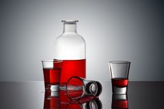 Red Drink on a glass bottle stock images