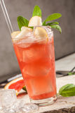Red drink with grapefruit, pears and ice Stock Photo
