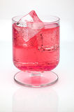 Red  drink with ice cubes Royalty Free Stock Image