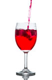 Red drink with ice cubes in a glass, Red soda in glass wine. Stock Photography