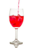 Red drink with ice cubes in a glass, Red soda in glass wine. Royalty Free Stock Image