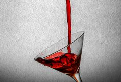Red drink pour at martini glass.  Stock Photos