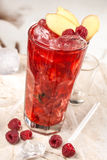 Red drink with raspberries and ginger Royalty Free Stock Photography