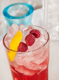 Red drink with raspberries and ice, focus Royalty Free Stock Photos