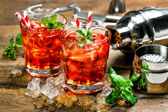Red drink with strawberry, mint leaves, ice. Cocktail bar Royalty Free Stock Photo