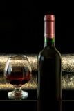 Red wine. Red drink is on the table  on a dark background Stock Image