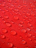 Red drops of water Stock Photos