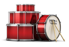 Red drum set with drumsticks Royalty Free Stock Image