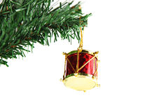 Red Druml hanging on branch Christmas tree. Stock Image