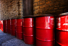Red Drums in Alley Way Stock Photography