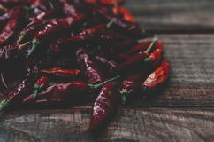 Red Dry Pepper. Red dry hot chili pepper on the wood rustic background Stock Photo