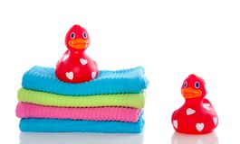 Red ducks on towels Stock Image