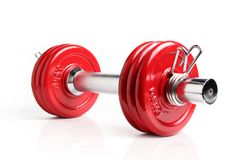 Red dumbbell. A red dumbbell isolated on a white background, with reflection Stock Photo